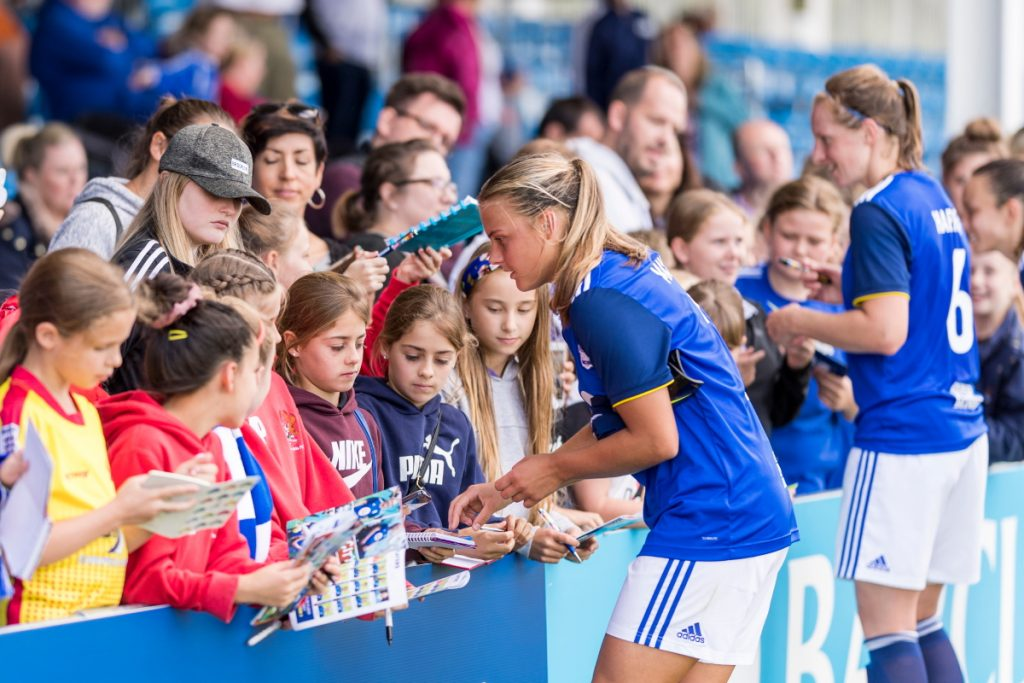 Sarah Mayling, Kerys Harrop and Lucy Staniforth spend time with young fans